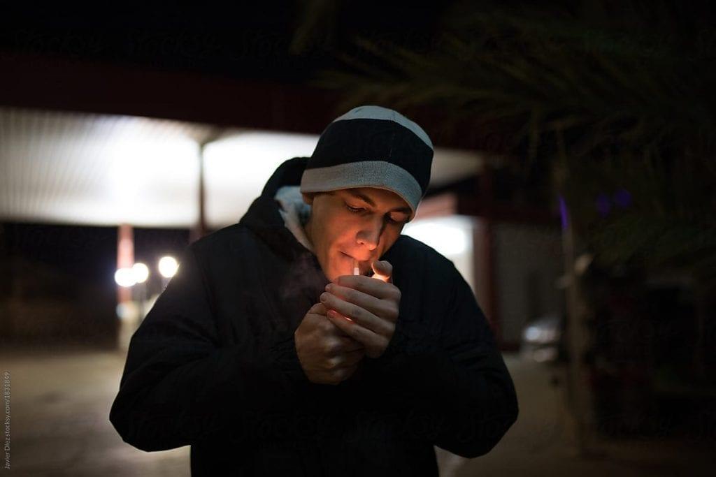 lighting cigarette